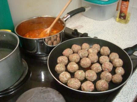 Cooking meatballs and tomato sauce